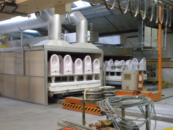 The ceramics are fired in a 340-foot-long, 2,200-plus-degree kiln. The sinks, toilets, and tubs are tinted either pink or blue from the glazing but come out a pure white on the other side.