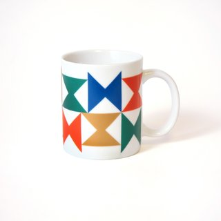 Inspired by the Miller House - Photo 1 of 5 - A boldly colored ceramic mug, with a pinwheel pattern for Georg Jensen tableware that was used at the Miller House.