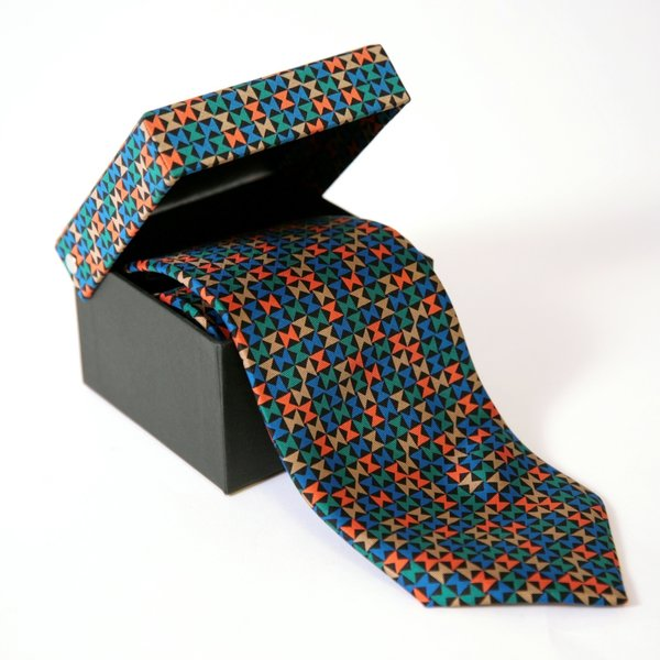 Inspired by the Miller House - Photo 4 of 5 - The Pinwheel pattern reappears in a different form on this graphic silk tie.