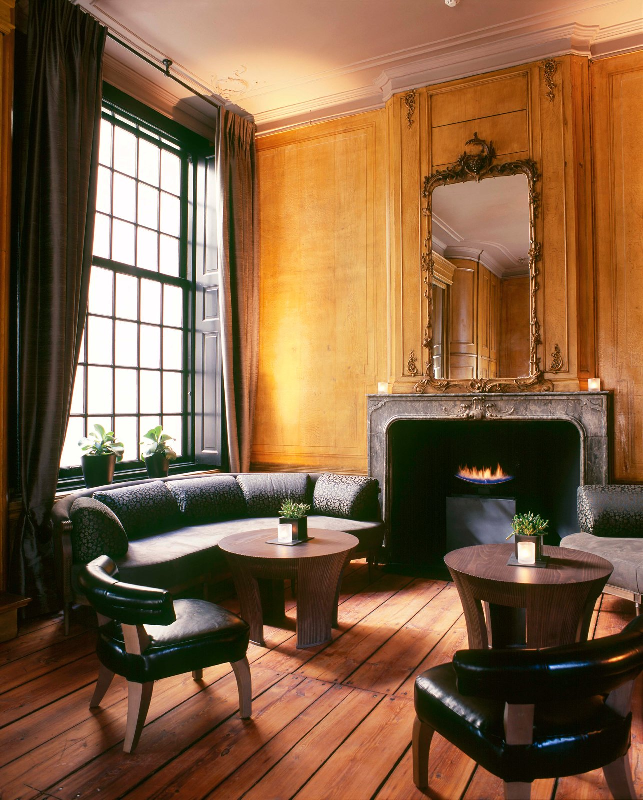 This was my favorite single space in the hotel—a lounge with a big marble fireplace, gilt mirror, and weathered wooden floor boards.  The Dylan, Amsterdam by Jaime Gillin