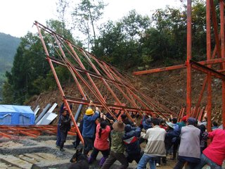 Curry Stone Prize Winner Announced - Photo 1 of 3 - Villagers raise one of the structures Hseih Ying-Chun designed.
