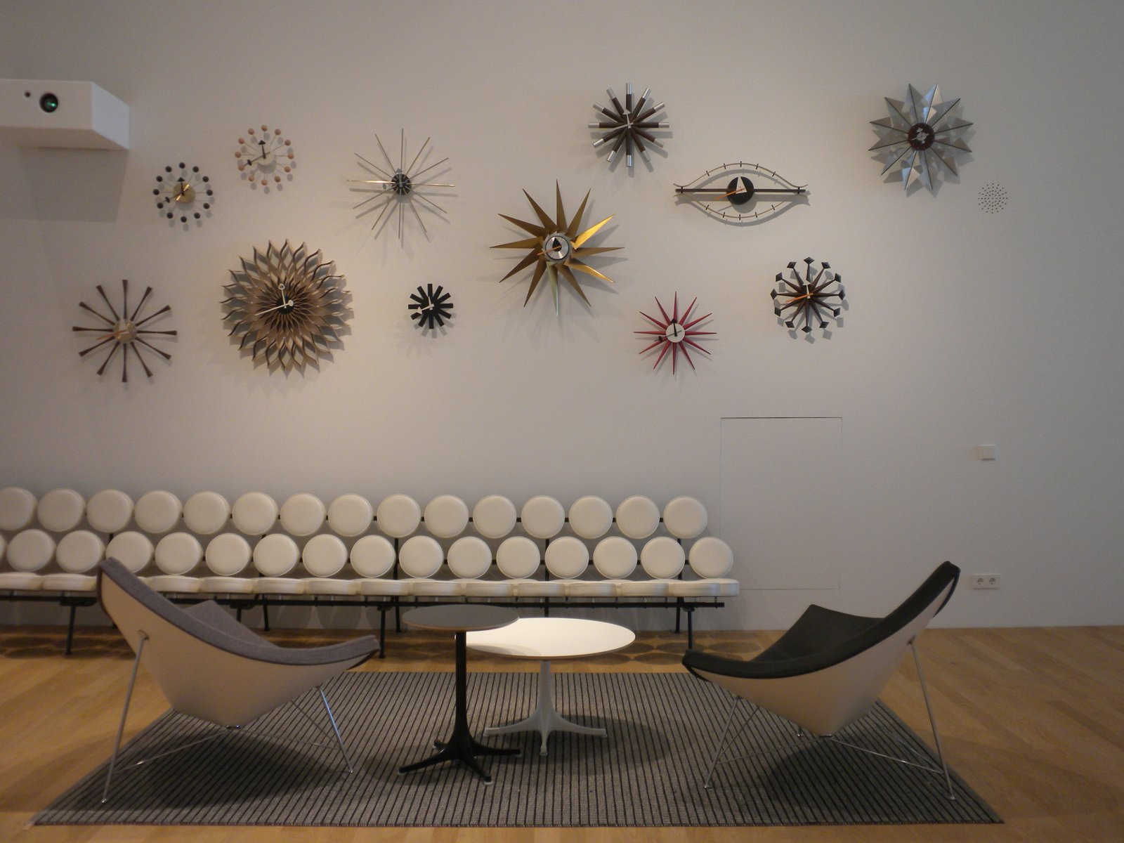 The area dedicated to designer George Nelson boasts the longest Marshmallow Sofa I've ever seen. Next to it are two of Nelson's Coconut chairs, designed in 1955, and above are an array of clocks by his hand.