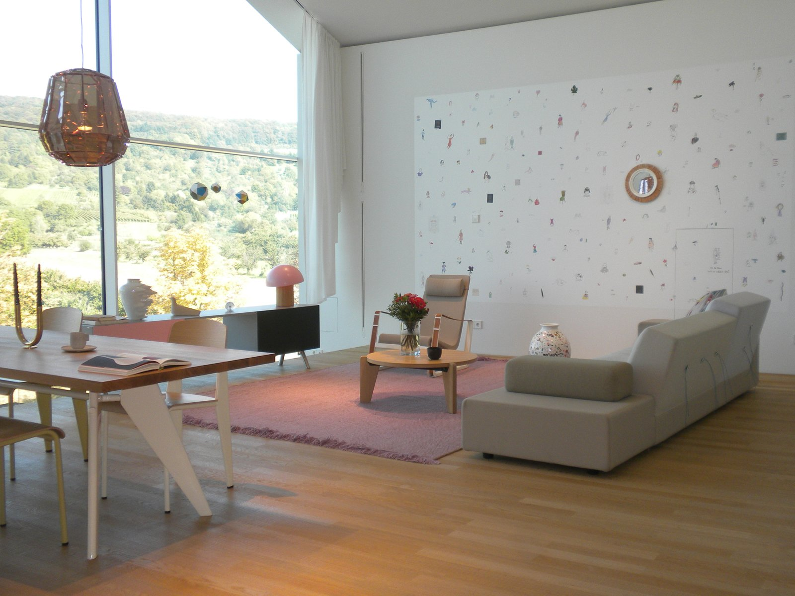 Serene settings like this one in the VitraHaus make you want to unpack and move in. This living and dining room features the Polder Sofa XL by Hella Jongerius, Kast console by Maarten Van Severen, Cité airchair by Jean Prouvé, Guéridon Bas coffee table by Prouvé, and Standard chairs around the EM Table by Prouvé. Inside the VitraHaus by Miyoko Ohtake