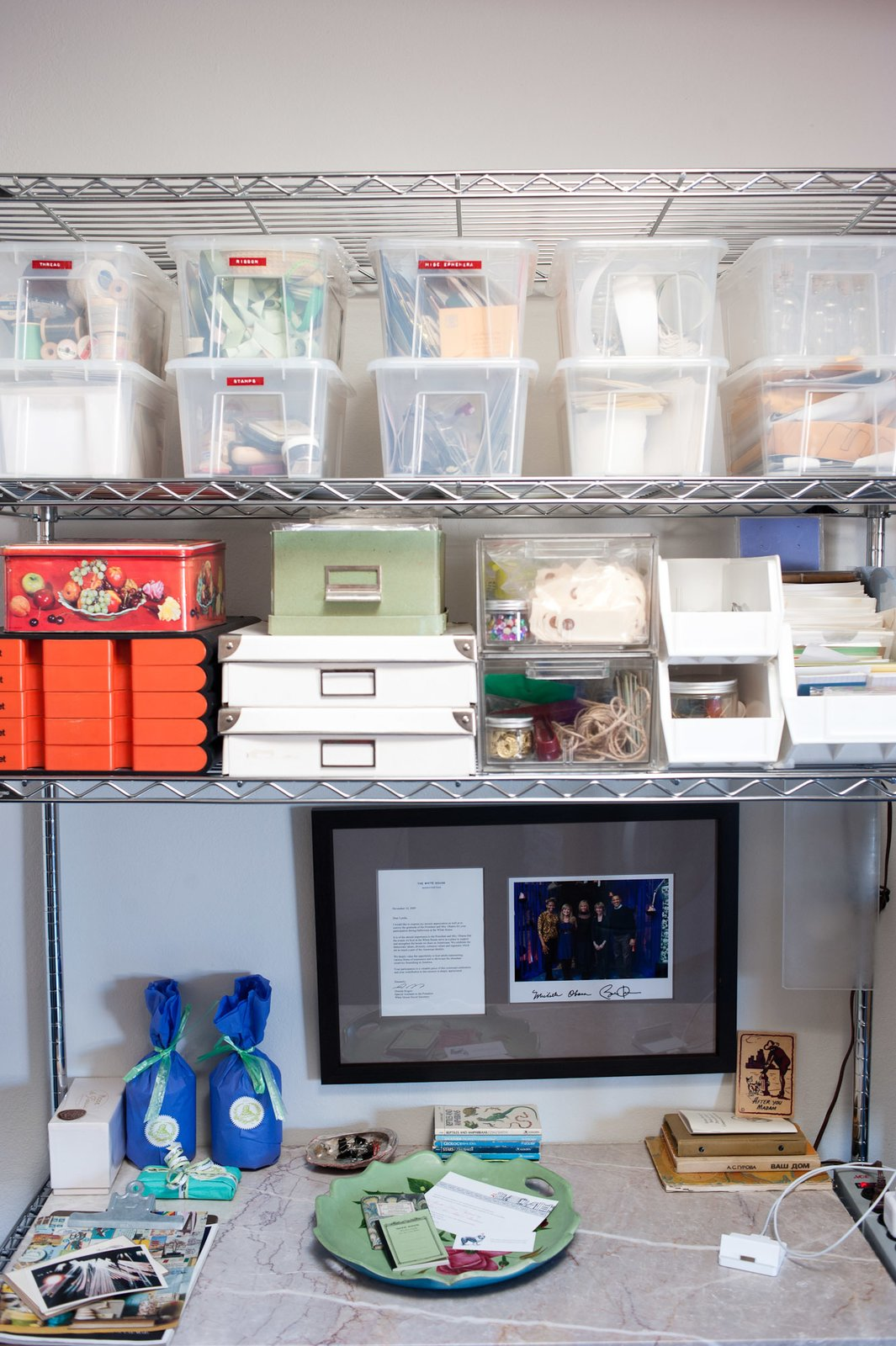 Lynda's knick knacks and crafty supplies are kept in the kitchen's metal shelving system, which came with the couple from their previous apartment. Tagged: Storage Room and Shelves Storage Type.  Photo 14 of 19 in Storage Savvy Renovation in Emeryville