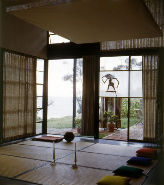 Goza mats and pillows are laid out for seating guests. The ocean can be seen beyond the corner window; it is now more obscured by trees. Photo courtesy the Eames Foundation.