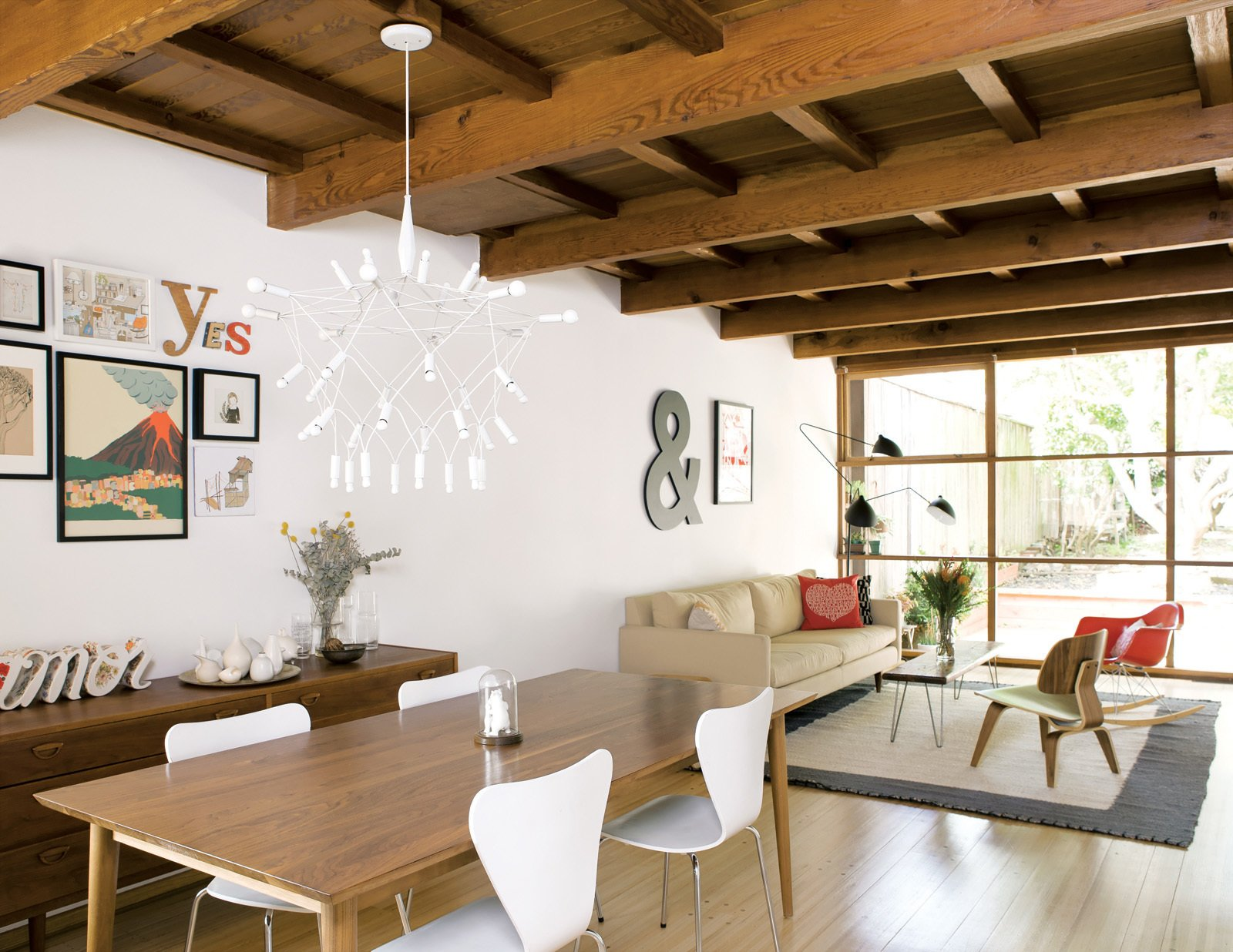 The couch and dining room table are from Room & Board; the Patrick Townsend Orbit Chandelier is from Velocity Art and Design.  Photo 6 of 10 in A Couple Tackles Conversion Challenges and Builds a Modern Renovation