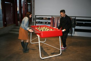 Roger Gastman at Ford & Ching - Photo 2 of 4 - Guests at the event face off on one of RS Barcelona's new foosball tables.