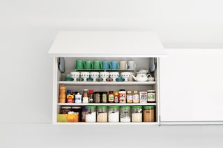 "Hide Your Food Away<br><br>The aesthetic throughout the house is supremely uncluttered, and that goes double for the kitchen, which dominates the central public space. ""My wife is the master organizer,"" says Paul. ""In Japan space is so tight, I think it is in their DNA."" The kitchen and wall-storage system by the German company Leicht continues the muted design palette and conceals it all from the microwave to the dishes.<br><br>leicht.de"