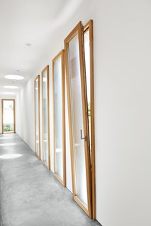 Easy Breezy<br><br>A deft cross-ventilation system keeps things cool in the summer. A series of tilt-turn low-E wood window-doors by Swiss manufacturer Gautschi not only allows passage to the side yard and a bit of extra natural light but, when tilted down, permits breezes to pass through the house.<br><br>gautschi-ag.ch
