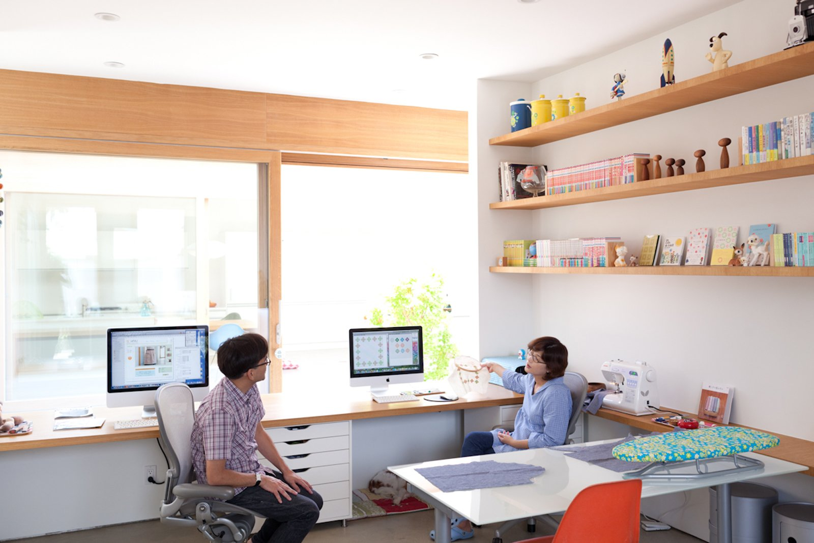 The pair of desks that Paul and Shoko work at in the office space look directly onto the courtyard. The concept for the design was to be able to see the sky from your seat at the desk.  Home Offices and Workspaces We Love by Matthew Keeshin from Looking Inward