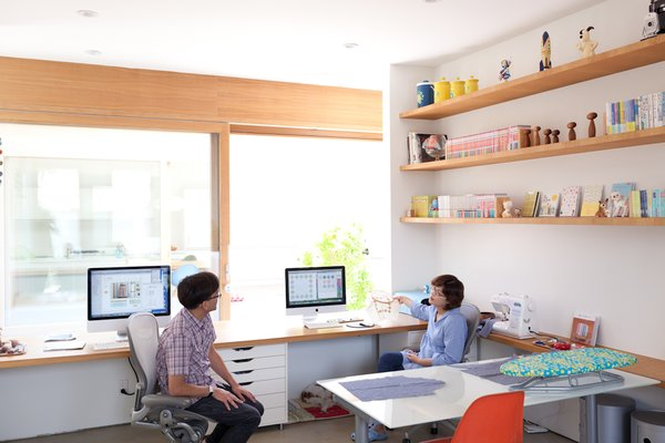 The pair of desks that Paul and Shoko work at in the office space look directly onto the courtyard. The concept for the design was to be able to see the sky from your seat at the desk.