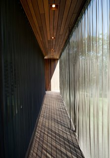 When extended, the metal-mesh curtain wall deflects the sunlight to mitigate the internal temperature of the structure. Similar energy-efficient gestures include geothermal heating and cooling, shading and venting systems, solar panels, and organic finishes and materials.