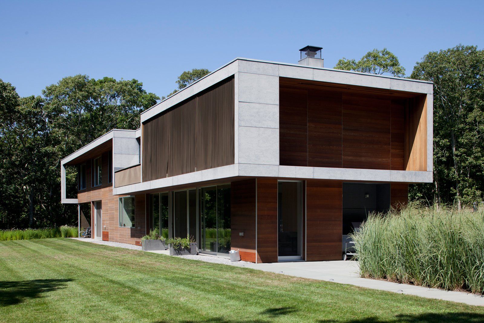 The 3,200-square-foot structure occupies a hillside site in Montauk, and enjoys a distant view of the ocean. Coen + Partners did the landscape design.  Photo 5 of 7 in Green Sustainable Home in Montauk