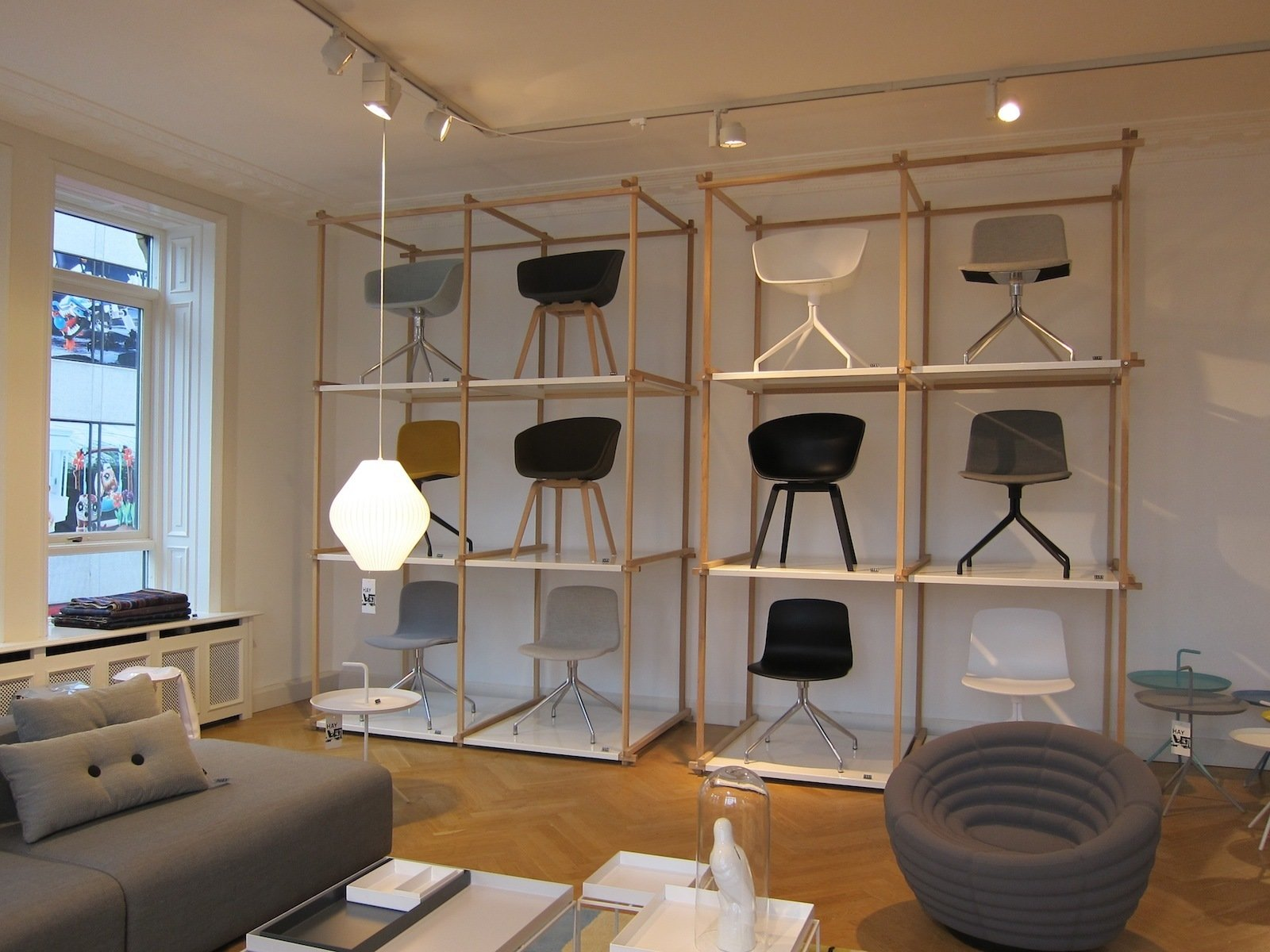 A grid-like display of chairs, with the upholstered foam Blow Chair by Foersom & Hiort-Lorenzen in the foreground.  A Visit to HAY Copenhagen by Jaime Gillin