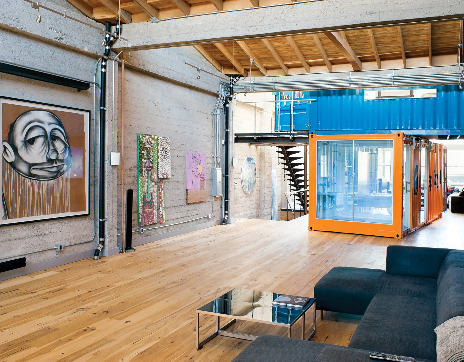 The shipping containers were stacked, joined with steel tubes, and lashed to reinforced floor joints to make them earthquake-safe. Tagged: Living Room, Sofa, Light Hardwood Floor, and Coffee Tables.  Shipping Containers by Dwell from Modern Shipping Container Home in San Francisco