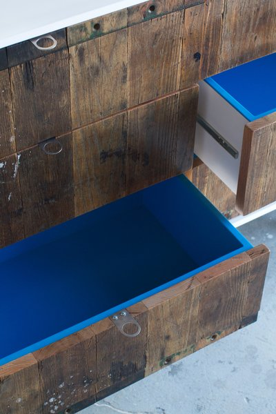 The wood used for the front of this dresser was taken from a 1950s factory cart. I really like the pop of cerulean in the drawers.