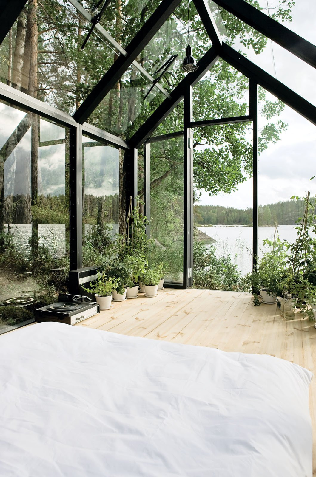 Helsinki architect Ville Hara and designer Linda Bergroth collaborated on a prefab shed-meets-sleeping-cabin, which can be assembled with little else than a screwdriver. Bergroth, inspired by nomadic yurt-dwellers, wanted an indoor/outdoor experience for her property in Finland. Tagged: Shed & Studio, Living Space, and Sun Room.  Botanical  Space by Brian Perez from Shedded Bliss