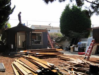 Dwell Home Venice: Part 5 - Photo 3 of 6 - Windows, doors and cabinets are stacked on the driveway. Lumber is sorted into piles according to size and type. The large front yard acts as a staging area.