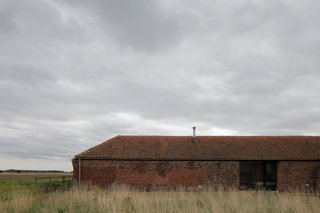 Long and low, the Ochre Barn began its life as a threshing barn in the 1850s.