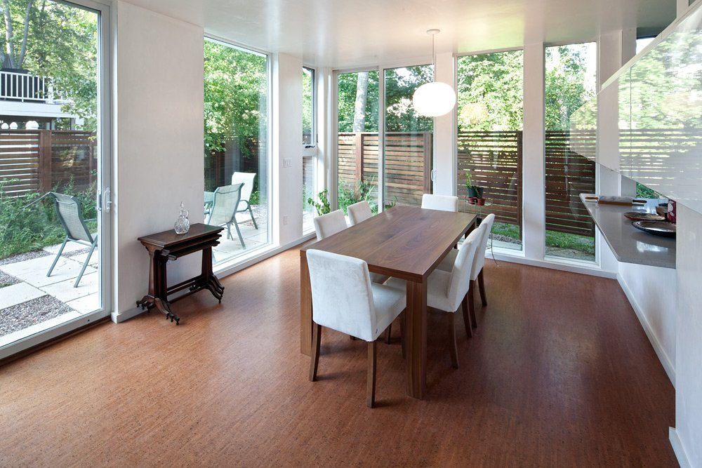 The dining room, just off the kitchen, is actually down a half level from the living room and entry. You can see the other outdoor room outside the sliding glass door.