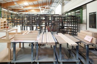 Ruché Sofa - Photo 3 of 11 - When an order comes in, workers feed the wood into a high-tech preprogrammed machine that mills it into ten square-sided posts and drills holes where the pieces will connect.