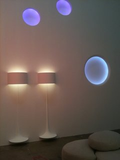 Flos Shop in San Francisco DZINE Showroom - Photo 4 of 9 - Two of Sebastian Wrong's Spun Lights hover over the floor, beneath three glowing Circle Lights.