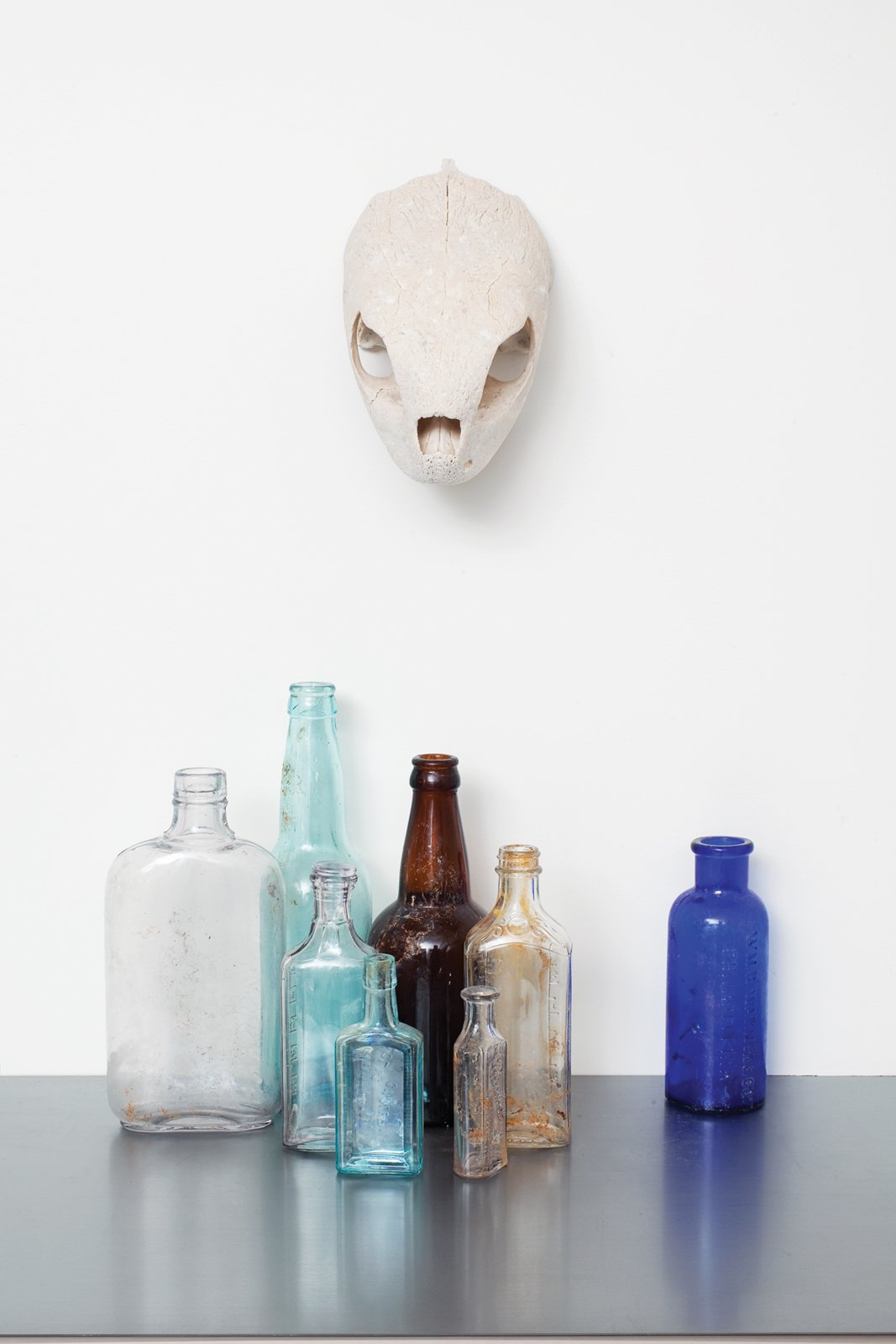Not only do these colorful bottles make for humble accent pieces, they're also a reminder of the house's past: Whitlock discovered them while building the home, which stands on what was once a Chinese apothecary.  Photo 8 of 16 in A Sound Professional Goes DIY While Building an Affordable Montana Home