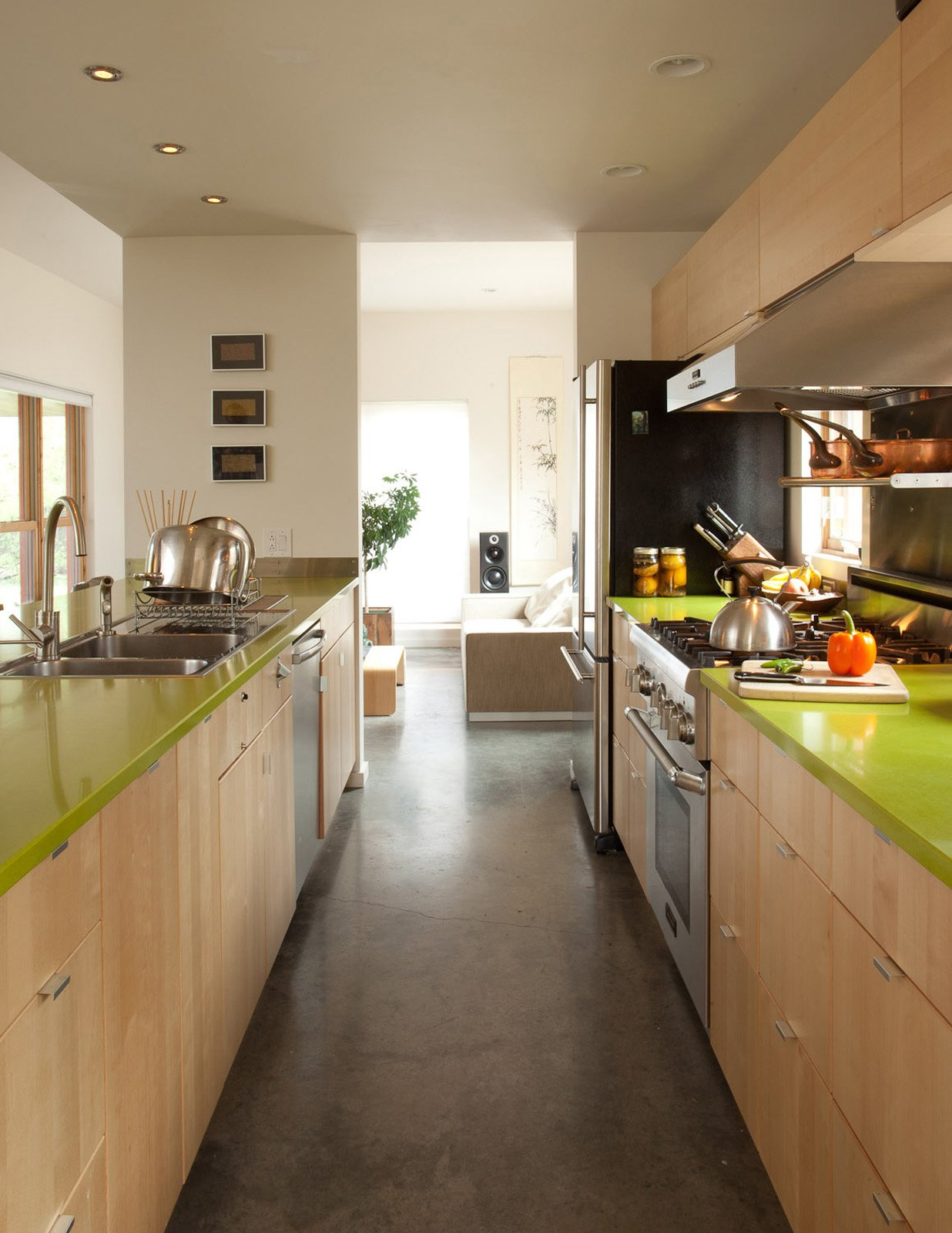 Here's another instance of a bit of bright color (on the countertops) giving an appealing accent to what is an otherwise pretty sedate palette. And if affordability is the name of the game, often a splash of color is more achievable than a spendy material.