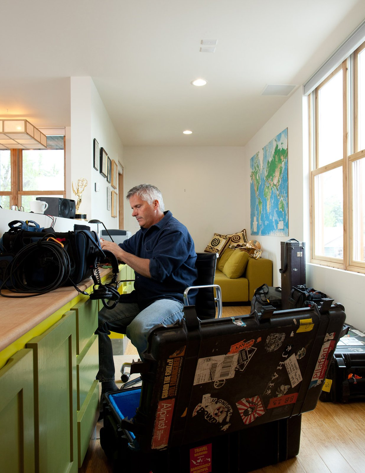 Whitlock hard at work with the tools of his other trade: sound mixing. A Sound Professional Goes DIY While Building an Affordable Montana Home - Photo 15 of 16