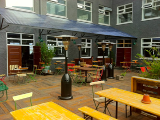 Shielded from the Atlantic wind, this cozy patio is a popular hangout for visitors and locals alike.