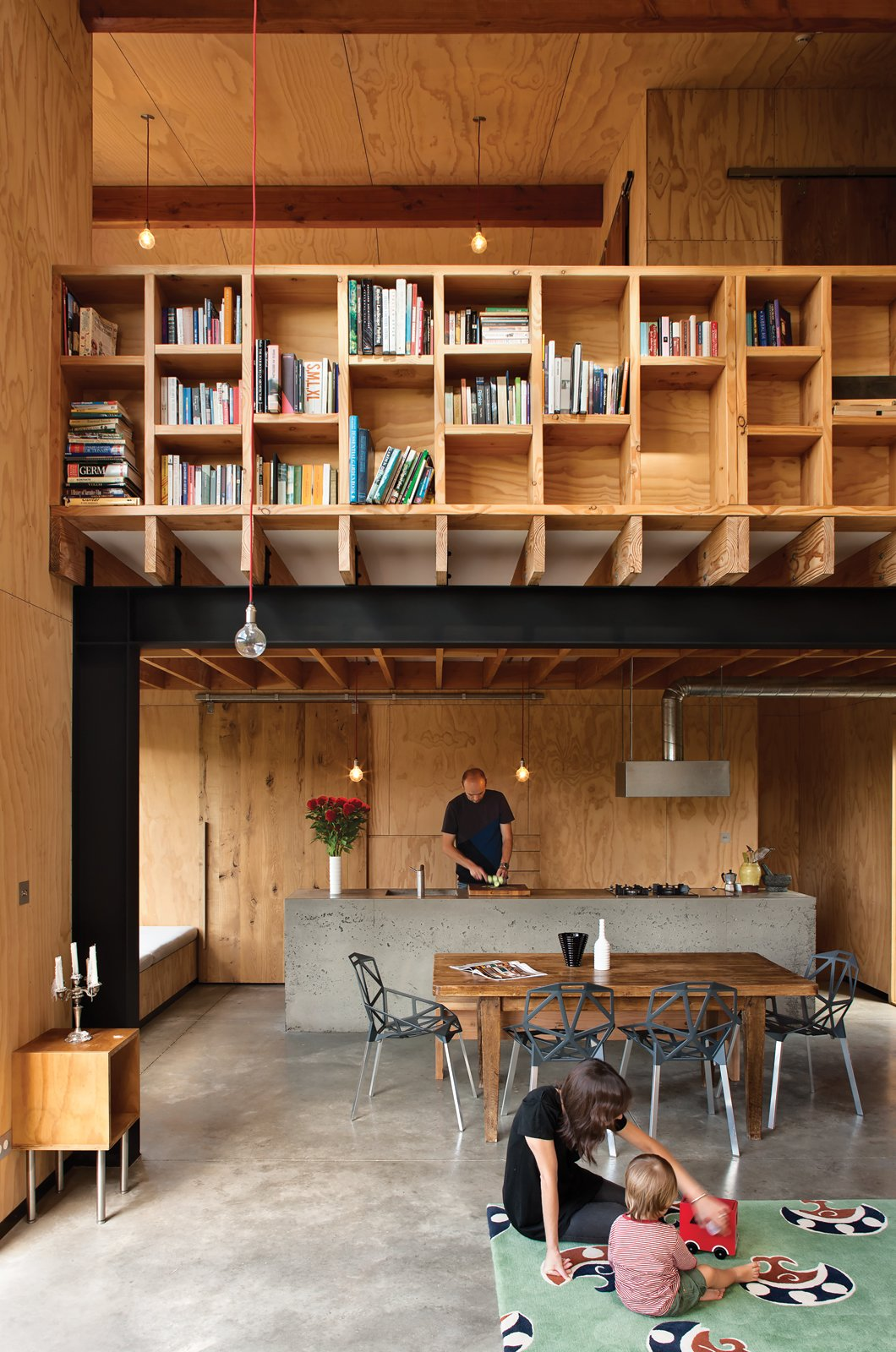 Davor (with his wife, Abbe, and son, August) designed the main living and dining pavilion as a double-height space to increase its perceived volume, and added high cubbies for extra storage. Tagged: Concrete Floor, Wood Backsplashe, Pendant Lighting, Concrete Counter, Shelves Storage Type, Shed & Studio, and Storage Space.  Photo 1 of 8 in Rock the Boat