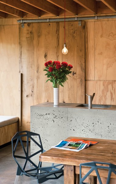 Island LifeThe appealing, handcrafted appearance of the concrete kitchen island is a happy accident, the result of the concrete not settling fully in its timber framing. When the framing was removed, the builder, Peter Davidson, was worried that Davor and Abbe would be disappointed with the bubbled result and offered to start the process again, but they loved its one-off feeling and persuaded him to keep it that way.