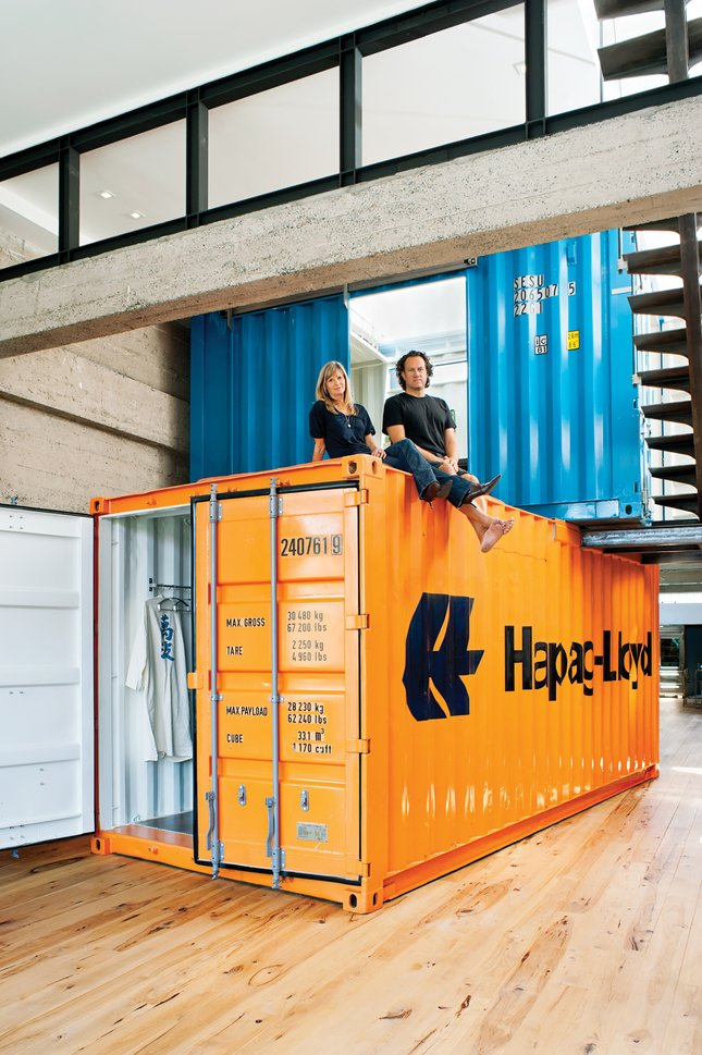 Their solution was to stack two shipping containers on top of each other, to create private space within the open-plan living area.  20 Ideas On What You Can Do With Old Shipping Containers by Luke Hopping from Coolest Homes for Artists & Art Collectors