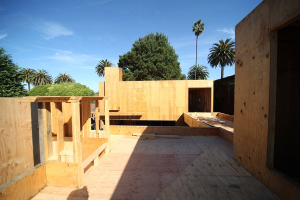 A view east from the rooftop garden above the master bedroom. On the right is the entry to the media studio and from there the bridge to one of the guest bedrooms. The foreground area is reinforced to withstand the strong loads from soil that will be installed in the garden.