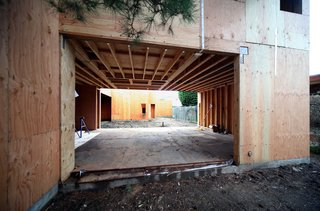 A view from the Pine Needle courtyard through the living/dining room to the main courtyard beyond.