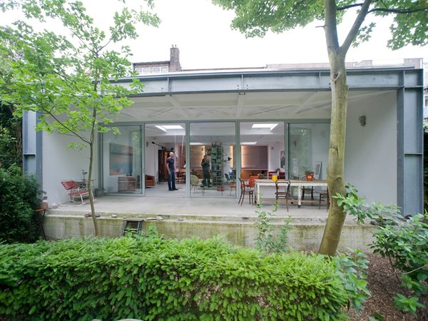 The whole rear of the home is open to the parkland setting, thanks to the glass wall and terrace. Photo 7 of Parksite Residence, Rotterdam modern home