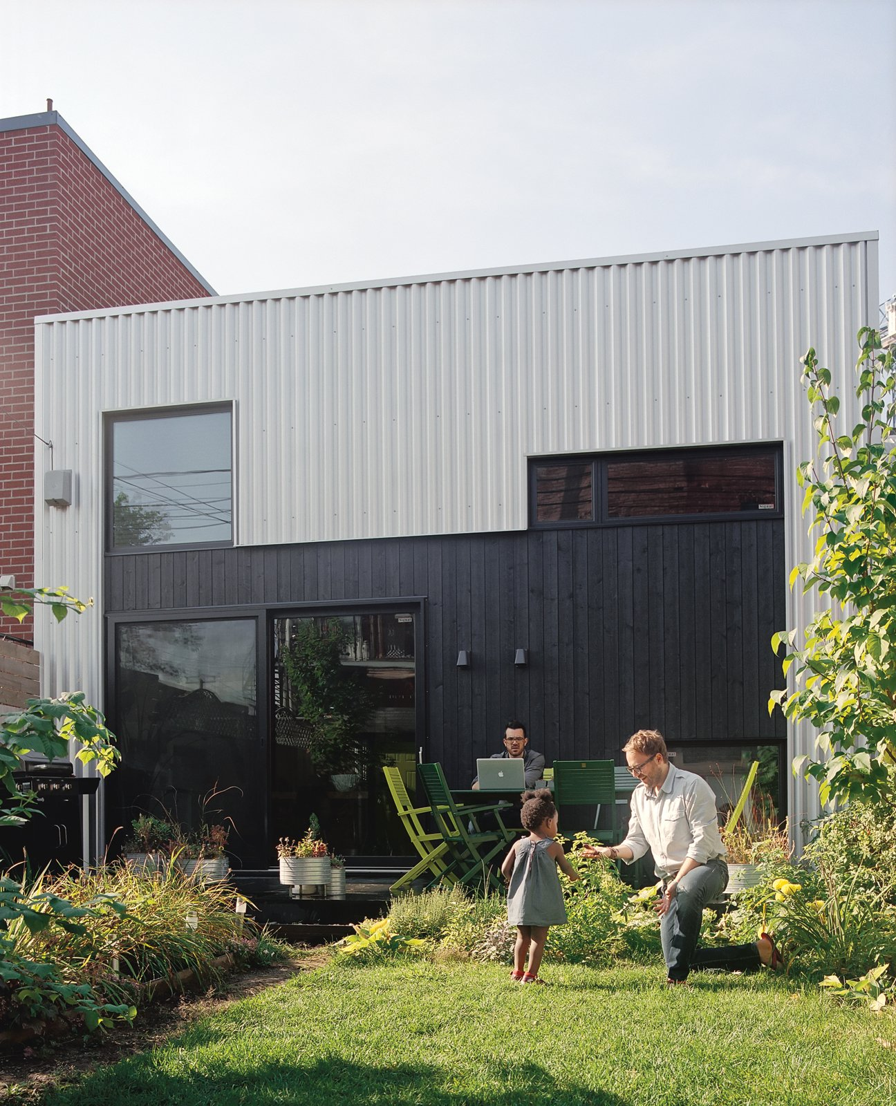 """Three things were clear when we started working with the architect: One, we had a limited budget; two, we had to plan for a kid; and three, every space had to be planned for—we didn't want extra space we didn't need.""—Francis Parisien Tagged: Exterior, Metal Siding Material, and House.  Photo 3 of 10 in Split the Difference"