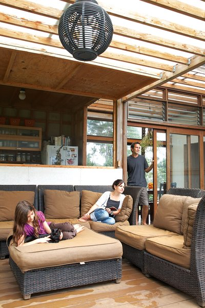 Just off the kitchen is the lanai, which serves as the family's main gathering spot. The polycarbonate roof lets light through but keeps the rain at bay.