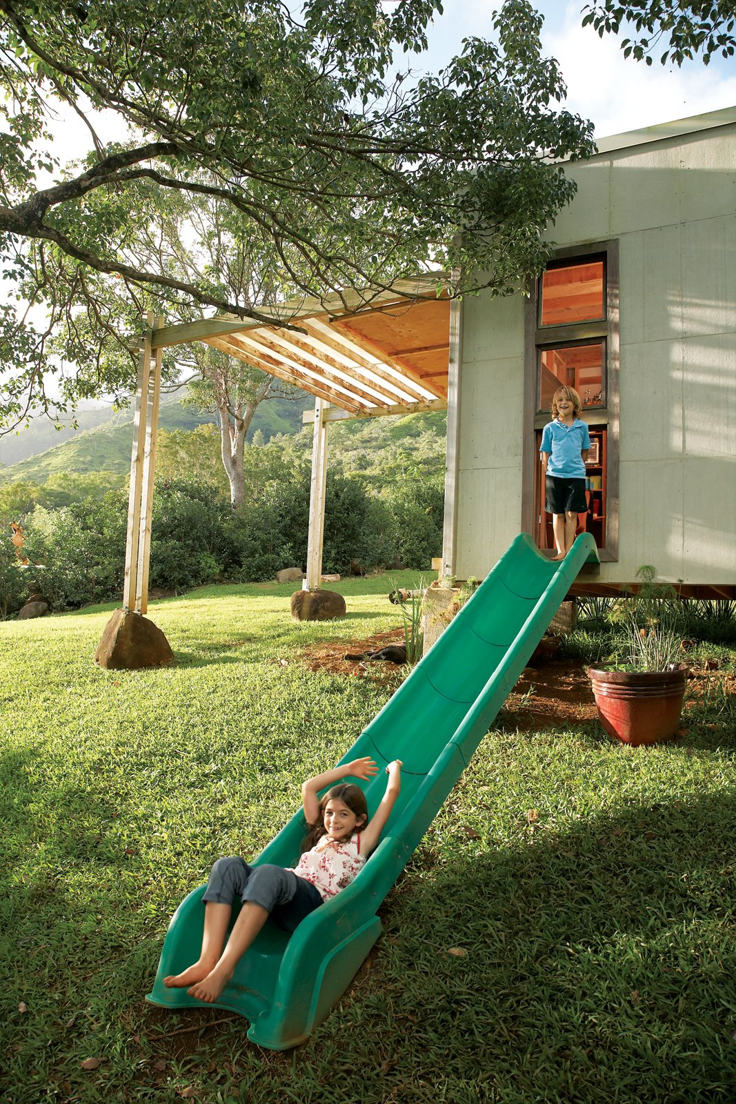 Jackson and Zeke escape their bedroom through a slide repurposed from an old play structure. The 20-acre property backs up to nearby mountains. Tagged: Grass, Shed & Studio, and Living Space.  Photo 10 of 22 in Grateful Shed