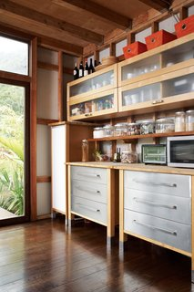 Grateful Shed - Photo 14 of 22 - Swede MotionWith no Ikea in Hawaii, the Gambys took advantage of a trip to Los Angeles during construction to pick up their kitchen cabinets—simple models made of glass, plywood, and particleboard. They shipped the cabinets to the island and, à la all things Ikea, put them together onsite, situating them high above the counter.<br><br>ikea.com