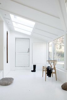 "The skylight over the home's entrance ""helps simulate a feeling of grandeur and creates an airy and welcoming atmosphere,"" says Bjerre-Poulsen."