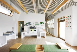 Modern Green Concept House in South Korea - Photo 3 of 10 - Smart GalleryThis second-floor gallery displays the green materials and technologies Unsangdong and Kolon built into the house. The two firms teamed up on the furniture design as well.
