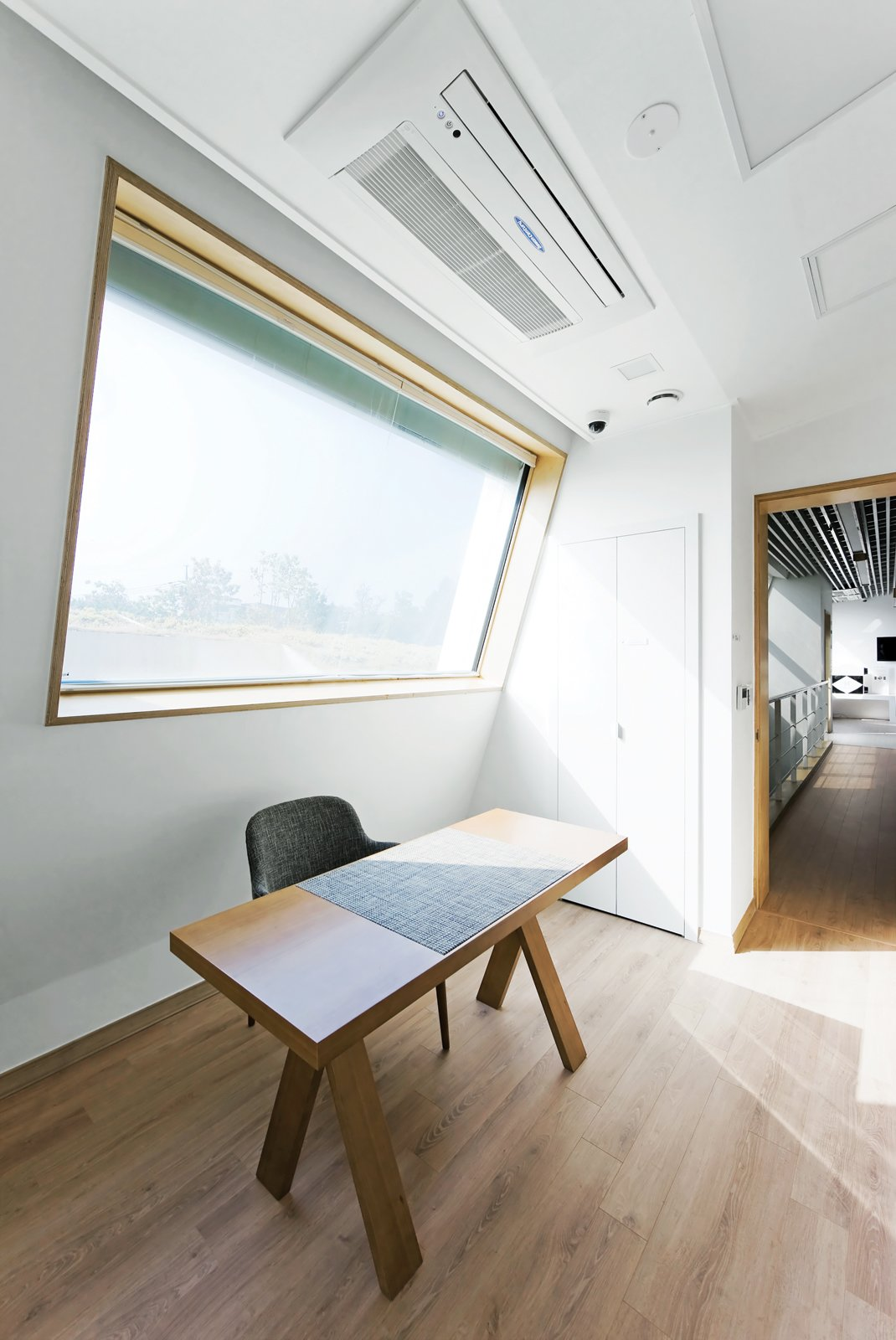 Just Venting  Though a tight thermal envelope is critical to the E+ Home's sustainability,   Kolon's heat recovery ventilation and air filtration systems (above the desk) help ease the load. Modern Green Concept House in South Korea - Photo 4 of 10