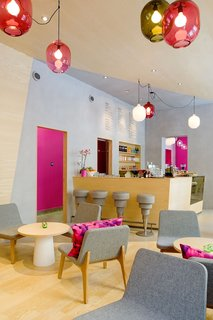 """As you can see from the bright accents of powder blue and Barbie pink, the interior is meant to elicit a strong response. According to Note, owner Michael Toutoungi said that he wanted a space that """"people either love or hate and that nobody is indifferent to."""" The aesthetic is definitely stronger and more playful than most cafe's I've visited."""