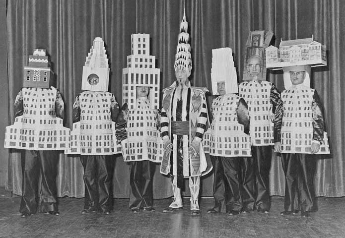 1931 Beaux-Arts Ball at the Hotel Astor. (L-R) A. Stewart Walker as the Fuller Building, Leonard Schultze as the Waldorf-Astoria Hotel, Ely Jacques Kahn as the Squibb Building, William Van Alen as the Chrysler Building, Ralph Walker as the Irving Trust, D.E. Ward as the Metropolitan Tower, and Joseph Freedlander as the Museum of the City of New York.  Photo 3 of 3 in Ralph Walker Renaissance