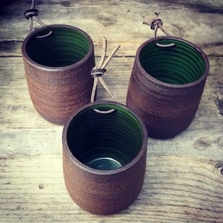 Here's a trio of the Bamboo series planters. The rough brown exterior is contrasted nicely with a smooth green glaze inside.