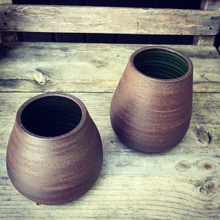 These rounder vases are from the UPO series. They can either sit on their own or hang suspended from a leather cord.