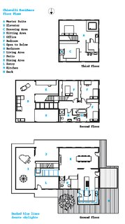 The floor plan shows three of the house's four levels; the basement level contains a wine cellar and laundry room.