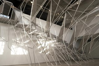 "Live Wire, a temporary installation at the Sci-Arc Gallery, is a staircase made of 1"" aluminum tubing and perforated metal panel."