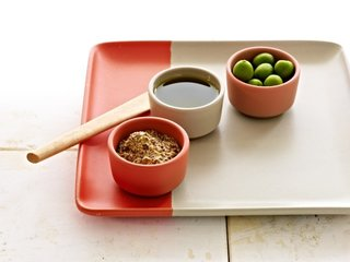 New Summer Colors from Heath Ceramics - Photo 2 of 4 - A two-tone tray in Poppy-dipped Birch is the perfect backdrop for a trio of condiment bowls in poppy, birch, and grapefruit.